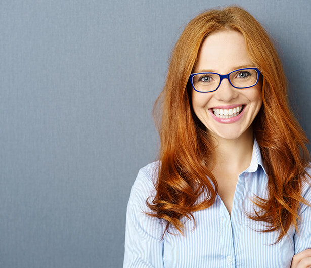red-haired office woman smiling
