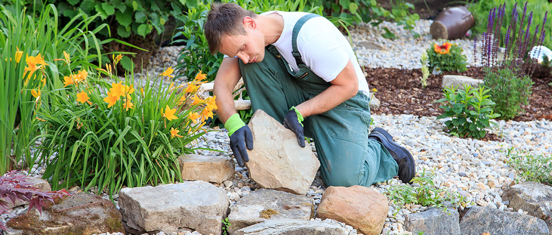 Landscaper laying rocks